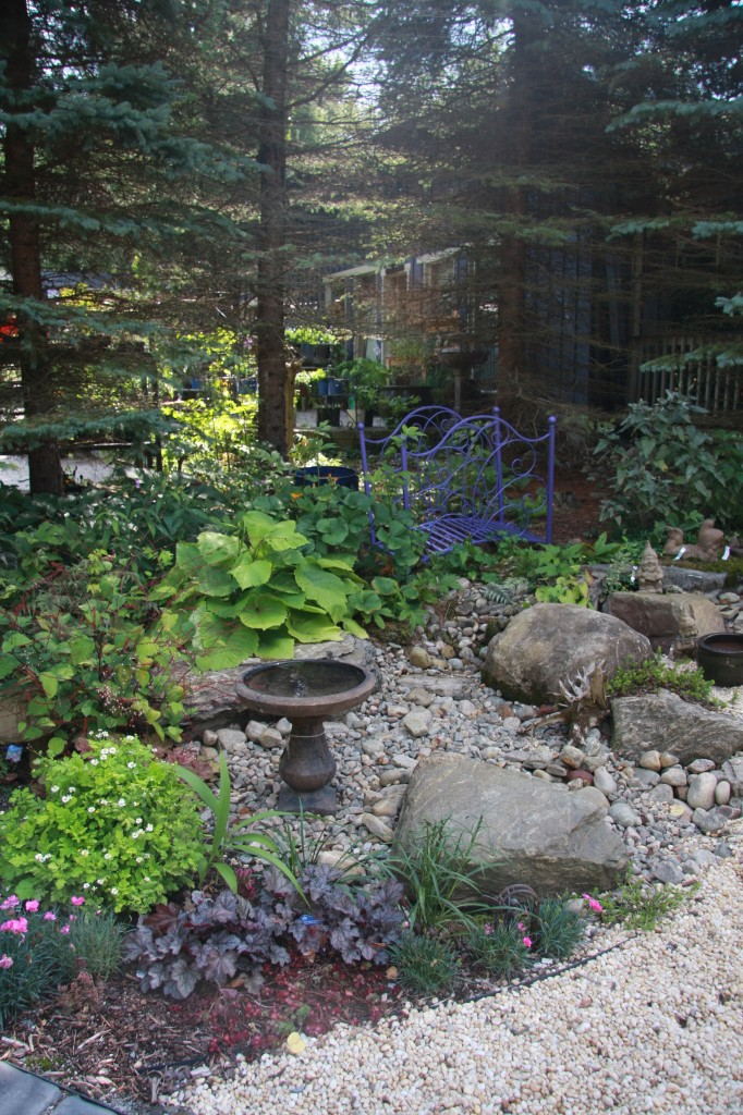 Display Garden Featuring a Dry River Bed